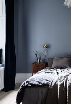 Stylish muted blue bedroom - via Coco Lapine Design blog