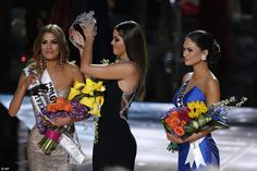Decision: It was actually Miss Philippines Pia Alonzo Wurtzbach who had taken the crown, and Miss Gutierrez had to bend down and allow Former Miss Universe Paulina Vega to remove it from her head