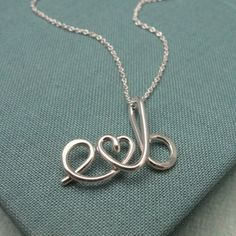 "necklace like this but with the word ""love"" in the font of that tattoo I pinned before..."