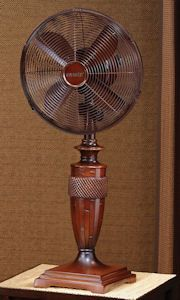 """Honduras Table Top Fan.  Made of Resin & Metal.  Approximately 32"""" Tall x 12"""" Wide. 12"""" Fan Head.  Weighted Base. 3 Speed, Oscillating, 30 Watt Motor.  One Year Limited Warranty.  Color Cherry Wood.  Ground shipping only - no expedited shipping. $149.99."""