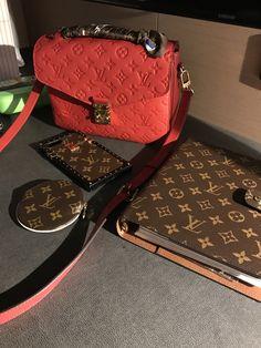 Louis Vuitton Pochette Metis in Empreinte Cherry Red, Monogram GM Agenda, Round coin purse, and iPhone 7+ case.