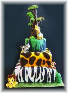 We love this safari themed baby shower cake by Craftsy member Gloria F.! The animals are adorable and the animal print fondant is genius! Click the image for a closer look at this fun project and be sure to click the heart to let the decorator know you love it! #cakedecorating