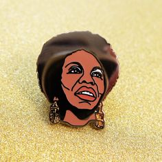 Nina Simone hard enamel pin badge. Inspirational singer and civil rights activist Nina in pin form. This pin is super polished (as you can see by the reflection of the camera lens in the photo) and...