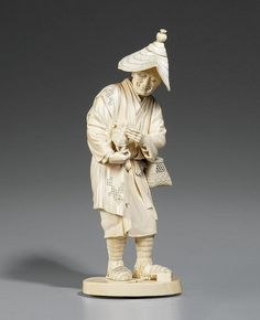 An ivory okimono of a peasant. Late 19th century