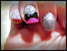 Pink and silver sparkly nails with a bow