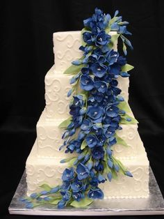 Looking for something blue for your wedding day? This impressive cascade of sugar flowers should do the trick. Creative Wedding Cakes, Wedding Cake Designs, Beautiful Cakes, Amazing Cakes, Our Wedding, Dream Wedding, Wedding Stuff, Blue Orchids, Orlando Wedding
