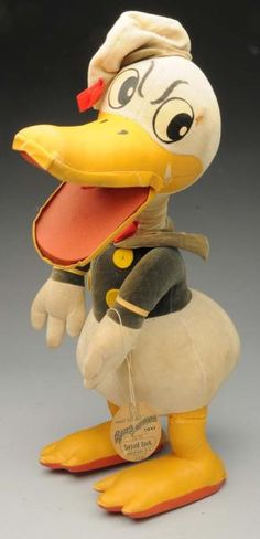 "Rare vintage velvet and oil cloth Donald Duck character toy with original label ""Walt Disney's Silly Symphony Toys Donald Duck Krueger, NY Trademark."""
