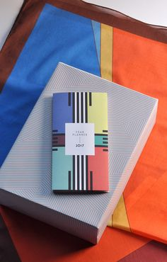 "Cotton Scarf ""Zürich"", Wrapping Paper ""The Pale Stripes"", Year Planner ""The Black Stripes"" - all made in Germany"