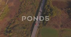 Cars and trucks traffic On Country Road. Aerial motorway through autumn nature - Stock Footage   by Droneye