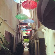 A little cafe hidden away in an alley of umbrellas in #Athens.