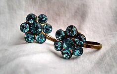 Vintage women's costume jewelry gold tone earrings flower design signed Coro