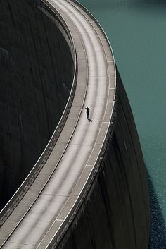 What makes this photo for me is his shadow…seeing the world through a lens is much different than simply taking a photo. Very cool work.  temperatures:    Man and Water