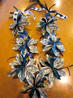 Graduation Candy Lei Ideas Graduation candy lei ideas Get fresh etsy trends and unique gift ideas delivered right to your inbox. See more ideas about graduation leis money lei a. Money Lay For Graduation, Diy Graduation Gifts, Leis For Graduation, Jolly Rancher, Money Origami, Diy Money Lei, Origami Paper, Creative Money Gifts, Money Flowers