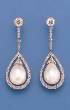 A PAIR OF BELLE EPOQUE PEARL AND DIAMOND PENDANT EARRINGS. CIRCA 1910. Each designed as a drop-shaped pearl weighing approximately 32.4 grains (8.1 carats) and 34.4 grains (8.6 carats) respectively, with diamond-set cap and rose-cut diamond surround to the diamond collet line and later collet surmount, millegrain setting, 4.6 cm. long.
