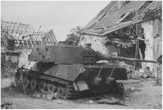 """A destroyed King Tiger during operation Market Garden. It sat on the edge of the British perimeter, adjacent to a farm building & a school """"Klompenschool"""". It was one of 14 tanks of the 3/s.Pz.Abt.506. This unit was part of the 9th. SS Panzer Division 'Hohenstaufen' and was sent to Oosterbeek. It was part of KGr. Von Allwörden. On Sept 25th it was knocked by the British. The tank burned out completely, even the Zimmerit layer melted down. It had a black number on the turret & a yellow edge."""