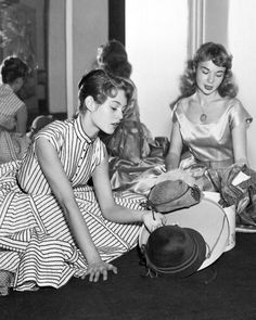 Brigitte Bardot and Francoise Arnoul choosing hats.