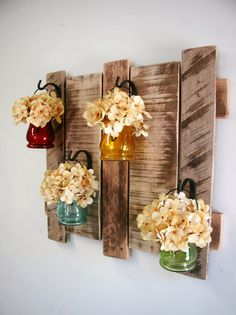 Pallet wall decor with colored hanging by PineknobsAndCrickets