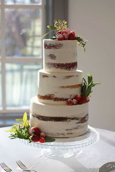 Semi-naked wedding cake with berries and greenery Rustic winter wedding  | Cakeity Cakes
