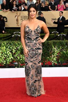 The SAG Awards 2017 Red-Carpet Looks. Gina Rodriguez looks very stylish in her Frazer Harrison gown, with chignon.