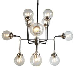 This 12 light chandelier is the perfect finishing touch for any room. Clear glass emits light beautifully and also draws attention to the piece. The simple lines of its iron frame give it a more modern appearance. Add a beautiful contemporary touch to your home or business with this stunning chandelier.