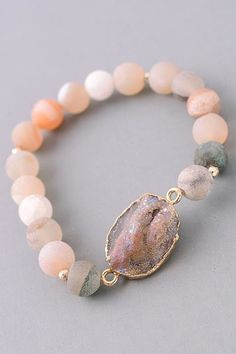 Gorgeous hand made bracelets with natural stones. Gold accents, slip on stretchy bracelet. Natural stones may vary in size and color. Great with any outfit!