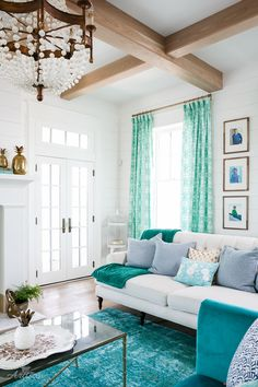 turquoise and white living room with shiplap walls