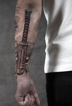 Excalibur tattoo © tattoo artist Niki Norberg forearm tattoos Niki Norberg, the Master of Hyperrealistic Tattoos - KickAss Things Hand Tattoos, Bird Tattoos Arm, Cool Forearm Tattoos, Best Sleeve Tattoos, Tattoo Sleeve Designs, Tattoo Designs Men, Body Art Tattoos, Tattoo Drawings, Tattoo Sketches