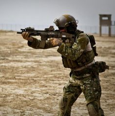 Army Ranger with the Battalion, Ranger Regiment takes aim with a SCAR-L MK 16 CQC during tast force training, The CQC is a x carbine in limited use within Special Operations Command (SOCOM) units, including the Rangers.