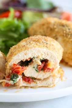 Chicken breasts stuffed with Sun Dried Tomato Bruschetta, mozzarella and spinach rolled, breaded and baked in the oven. Easy to make, and the chicken comes out so juicy and delicious!