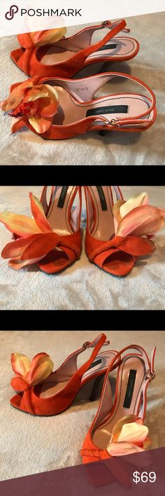 Paola Conte flower shoes Beautiful shoes with orchids. Gently used condition. Very elegant and unique. Please see all imperfections on the last 3 pictures. Don't have an original box because my mom bought them in Europe. Paolo Conte Shoes Heels