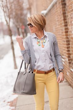 I like everything about this outfit--the yellow jeans, grey sweater, light grey blouse, and pastel colored necklace. The grey bag is cute, too!