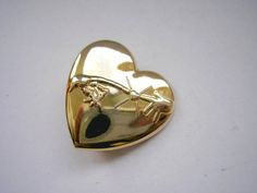 Vintage ETmovie collection gold tone metal heart by badgestuff, $6.00