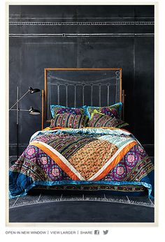 @Jerri Schjott I love this quilt.   Pretty bedding with DIY walls.