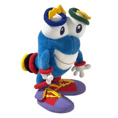 """Izzy Mascot of the 1996 Olympic Summer Games in Atlanta, USA  Izzy was the first mascot designed by computer. It was an amorphous abstract fantasy figure. It carried the name Izzy, derived from """"What is it?"""" because no one seemed to know exactly what Izzy really was."""