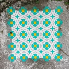 javier de riba paints patterned tiles onto floors of abandoned urban spaces