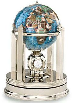 Gemstone Globe - Marine Blue (Free Shipping) Gemstone globe is handmade with an assortment of semi precious stones that are individually carved into the shape of countries. Oceans are made from Marine Blue gem stone. Latitude, longitude and international date line are added with a fine gold or silver thread. Gem stone globe is positioned on top of a rotating gold or bright silver clock stand which features 3 clocks, each showing a different time zone setting, as well as a thermometer.