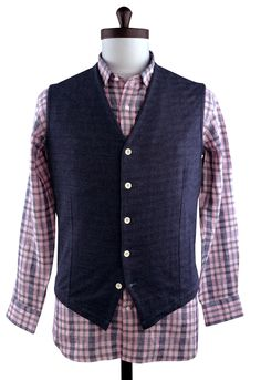 Luxire waist coat constructed in Indigo Casual Polo: http://luxire.com/products/indigo-casual-polo  With bone buttons.