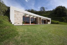 This amazing, ultra-modern earth-sheltered home in ecuador is pristinely blended with its surroundings. With a thin green roof over an amazing minimalist layout, the home should be a beacon for the future of eco-development. Green Building, Building A House, Gazebo, Earth Sheltered Homes, Minimalist Layout, Underground Homes, Earth Homes, Earthship, Modern Exterior