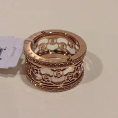 New Michael kors rose gold logo cut out ring 7 New with tags Michael Kors Monogram cut out Ring Rose Gold Size 7  Rose Gold colored stainless steel Tonal glass crystals frame the monogram cutout center. Logo engraving and nailhead studs on sides. Approx. 1/2 inches wide Includes signature dust bag. Retail $115+ Michael Kors Jewelry Rings