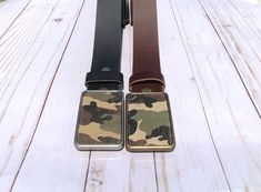 $25..A camouflage belt buckle is a great way to show off your fashion style. The rectangular buckle comes in both antique brass and silver finish. Pair the camouflage buckle with an interchangeable snap belt from Brooklyn Buckles and instantly make a stylish statement. The buckle fits on a belt with a width up to 1 1/2 inches. Shop one today!