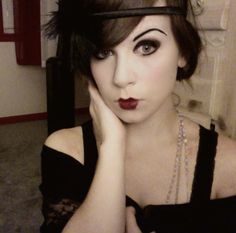 20's makeup with the dark think eyebrows, smokey eyes, and red lips