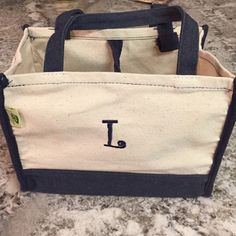 """NEW Two-Toned """"L"""" Monogrammed Mini Tote New, never used mini tote. Makes a perfect gift, makeup bag, beach accessory, etc! Versatile two-toned colors go with anything. Tie at top for extra protection. Bags"""