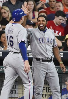 Texas Rangers' Ryan Rua (16) celebrates after scoring a run on Bobby Wilson's RBI-single with Elvis Andrus during the fourth inning of a baseball game against the Houston Astros, Sunday, May 22, 2016, in Houston. (AP Photo/Eric Christian Smith)