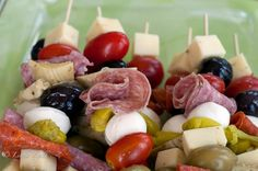 Ingredients are simple: cherry tomatoes, small balls of fresh buffalo mozzarella, green and black olives, Genoa salami, pepperoni, chunks of pepper jack cheese, marinated artichoke hearts and pepperochini. Make a bamboo skewer of all the ingredients…