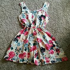 1 Hour Sale Floral Fit and Flare Dress NWT! Fit and Flare Dress. Light weight material. Perfect summer dress!!! 100% polyester. 32 inches. Runs on the smaller side - Would fit a Small! Cool Fashion Dresses Midi