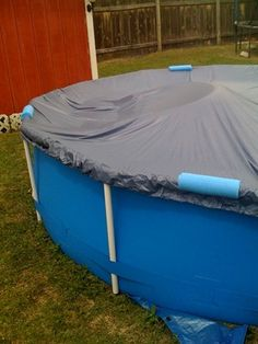 Using pool noodles to keep cover on. If you wanted to cover the POOL in the winter this might work!!!