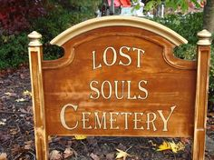 Cemetery sign made from goodwill headboard. GREAT idea!!!