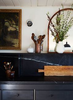 black marble kitchen countertop with floating shelf - via architectural digest - photo: Genevieve Garruppo