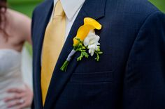 Yellow flower with white freesia boutonniere