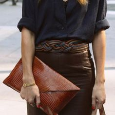 Brown leather skirt and black (dark navy?) blouse and the blue/brown belt that ties it all together... genius!
